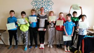 A photo of the 8 students with their computer camp certs with Sharon in the middle