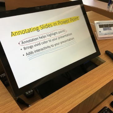 A picture of a screen with a slide and some annotation on the slide.